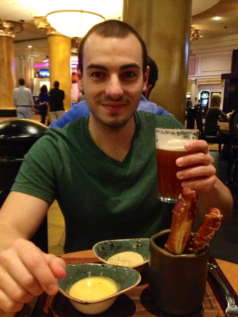 Neil enjoying beer and pretzels inside Caesars Palace.