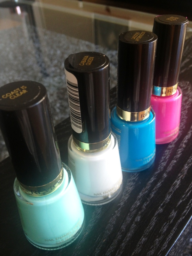 Four of the eight polishes that comprise the Revlon Haute Tropics Collection. From left to right: Coast Is Clear, Cabana Queen, Lagoon Afternoon and Belize, Please